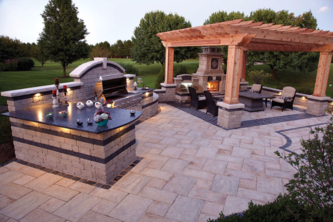 outdoor fireplace and kitchen with pavers, pergolas and granite countertops atlanta georgia