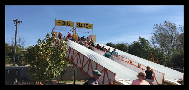 super slide for rent with people sliding down