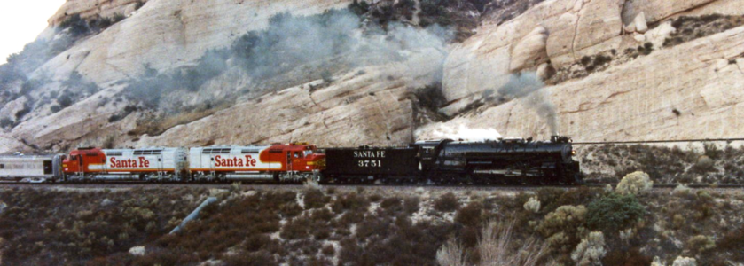 "ATSF 3751 passes Sullivan's Curve on California's Cajon Pass. The train is eastbound on 3751's ""maiden voyage"" after restoration to operating condition. Photo by Sean Lamb."