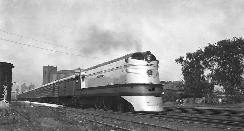 A Milwaukee Road Class A (A-1) streamlined locomotive leaving Minneapolis for Chicago as The Hiawatha. The locomotive is new and is on its afternoon run. Circa 1935.