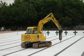 Heavy machinery working on pool removal