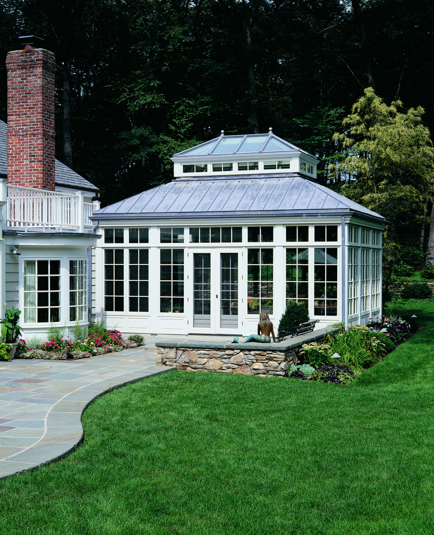Completed projects a wooden english styled conservatory achieves its classic design through the addition of decorative ornamentation
