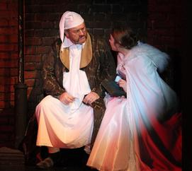 Scrooge (Mark Cooper) with the Ghost of Christmas Past (Mia Goddard)