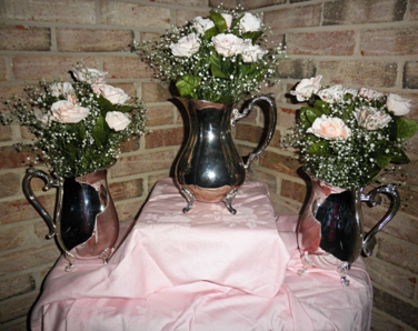 Silver teapot vases with babies breath for rent at Rent Your Event, LLC.