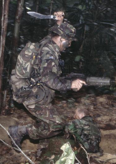 Gurkha using his kukri during a jungle exercise