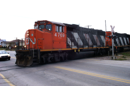 Canadian National 4769, a GMD GP38-2, with CN-spec comfort cab, St Félicien, Québec, Canada.