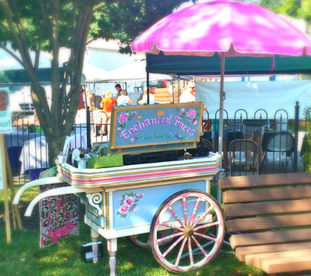 Enchanted Faces flower cart face painting station at the Sykesville Farmer's Market in 2016