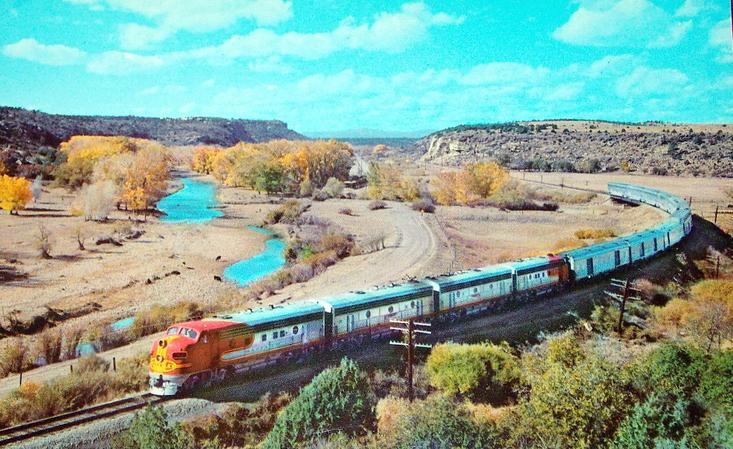 The Santa Fe's El Capitan passing through Shoemaker Canyon, New Mexico with Hi-Level equipment, circa 1950s.