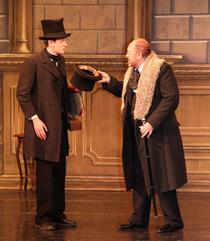 Crachet (Sam Scarisbrick) with Scrooge (Mark Cooper)