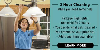 Picture of a maid cleaning a light fixture. Picture describes a 2 hour home cleaning service.