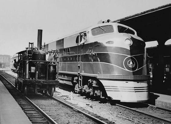 Photo of the Baltimore & Ohio's new EMD EA diesel locomotive for the Capitol Limited and the railroad's replica of their noted early steam engine, Tom Thumb. May 25, 1937.