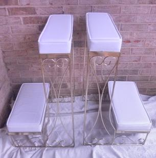 White leather wedding kneeling benches with gold trim for rent for your wedding at Rent Your Event, LLC near Charlotte, North Carolina.