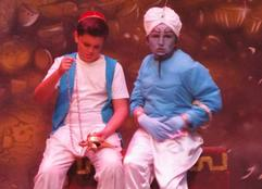 Aladdin (Alex Linton) and the Genie (Connor Cooper)