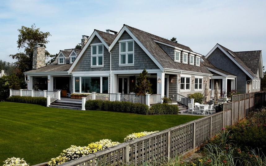 "Custom coated Western Red Cedar Shingles give this house a beautiful ""beachy"" feel"