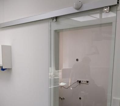 Magnetic sliding door opener