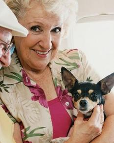 Elderly woman happy with her service dog