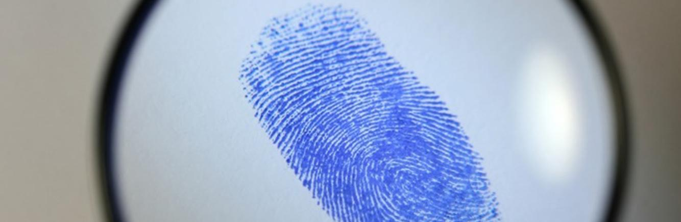 Magnifying glass image of a fingerprint - image appears on philipoldfield.com