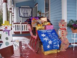 Image of Porch of the Wedgwood Inn during Holidays. Sleigh with gifts on porch.