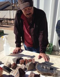 Mark Hileman with dinosaur bone rough