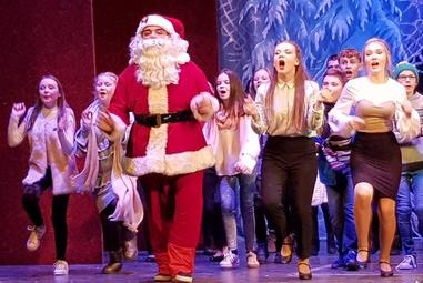 Santa (George Rees) and ensemble