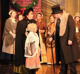 Scrooge (Mark Cooper) with ensemble