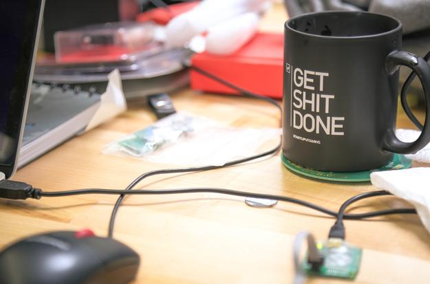 startup environment get shit done mug on table