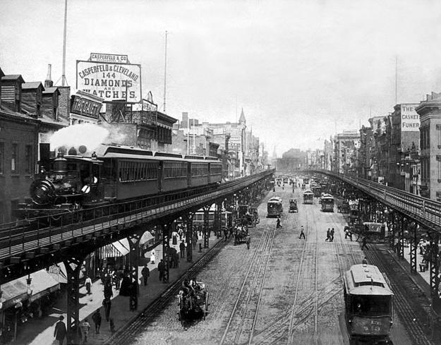 A Forney locomotive on the Third Avenue El, over the Bowery, New York City, 1896.