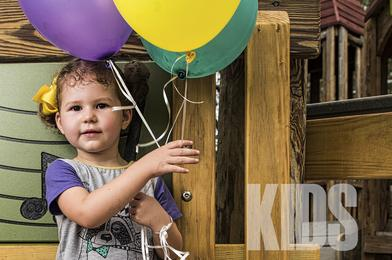 Picture of a toddler with ballons