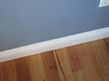 straight line painting on baseboard by Jcb Painting in Taunton, MA.