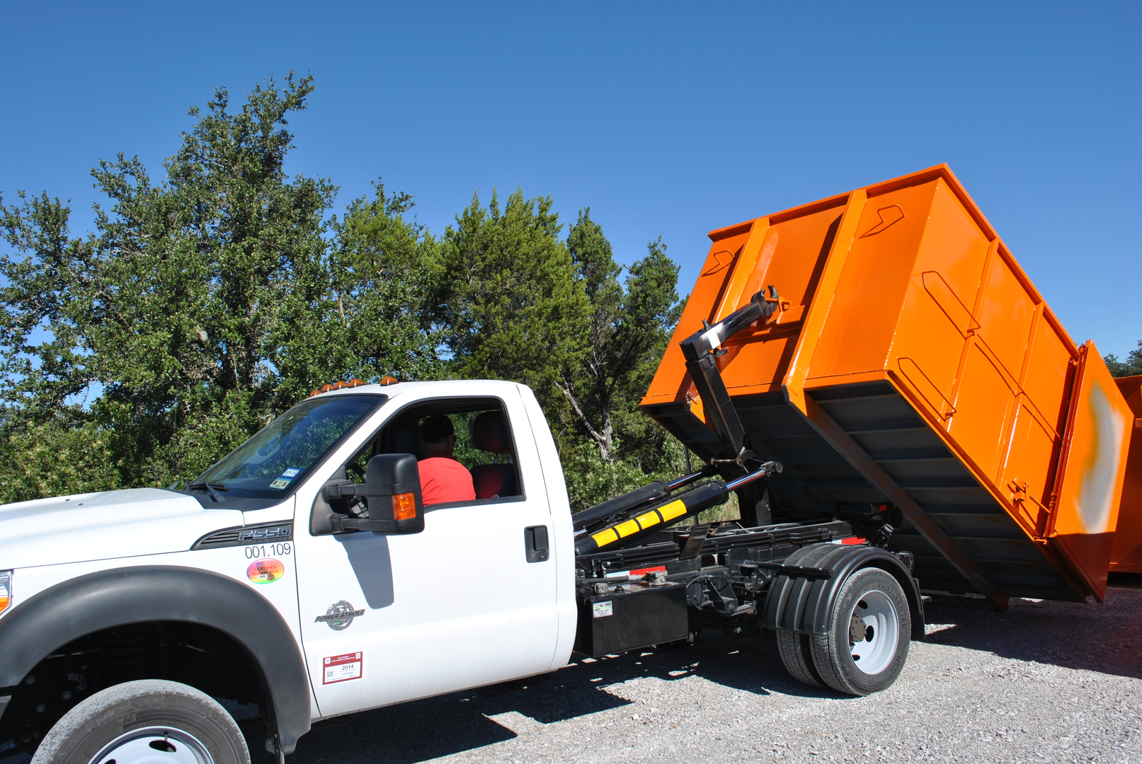 Front End Loaders Fel S Are Trucks With Hydraulic Forks On The To Lift Dumpsters Up And Dump Contents Into Box Of Truck