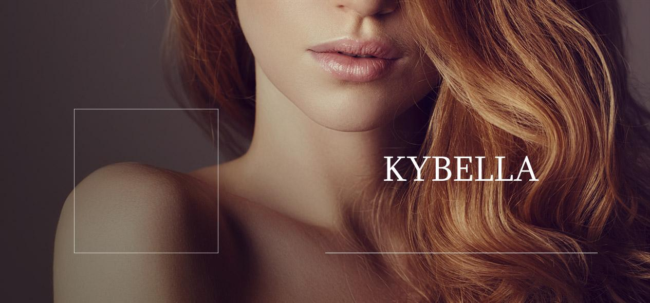 A red haded model highlighting her neck. Learn more about Kybella more.