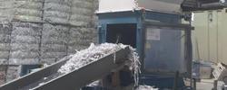 Shredded paper going into a baler