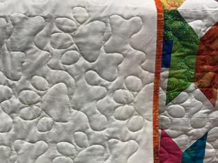 quilt back with pawprint stitching