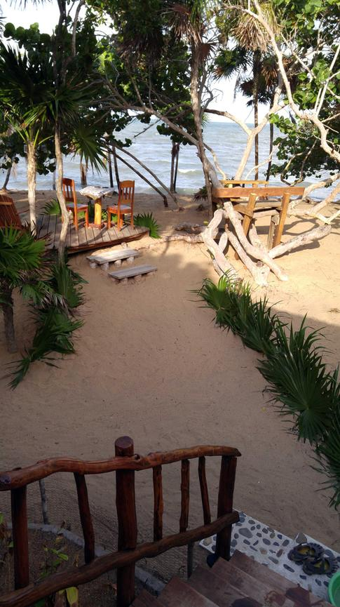 Your own private deck set right on the shores of the Caribbean Sea at Leaning Palm Resort in Belize.