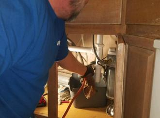 Plumber Cleaning Kitchen Drain in Lakeway, Tx