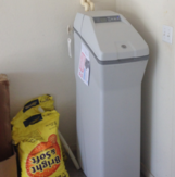 Water softener with salt bag.