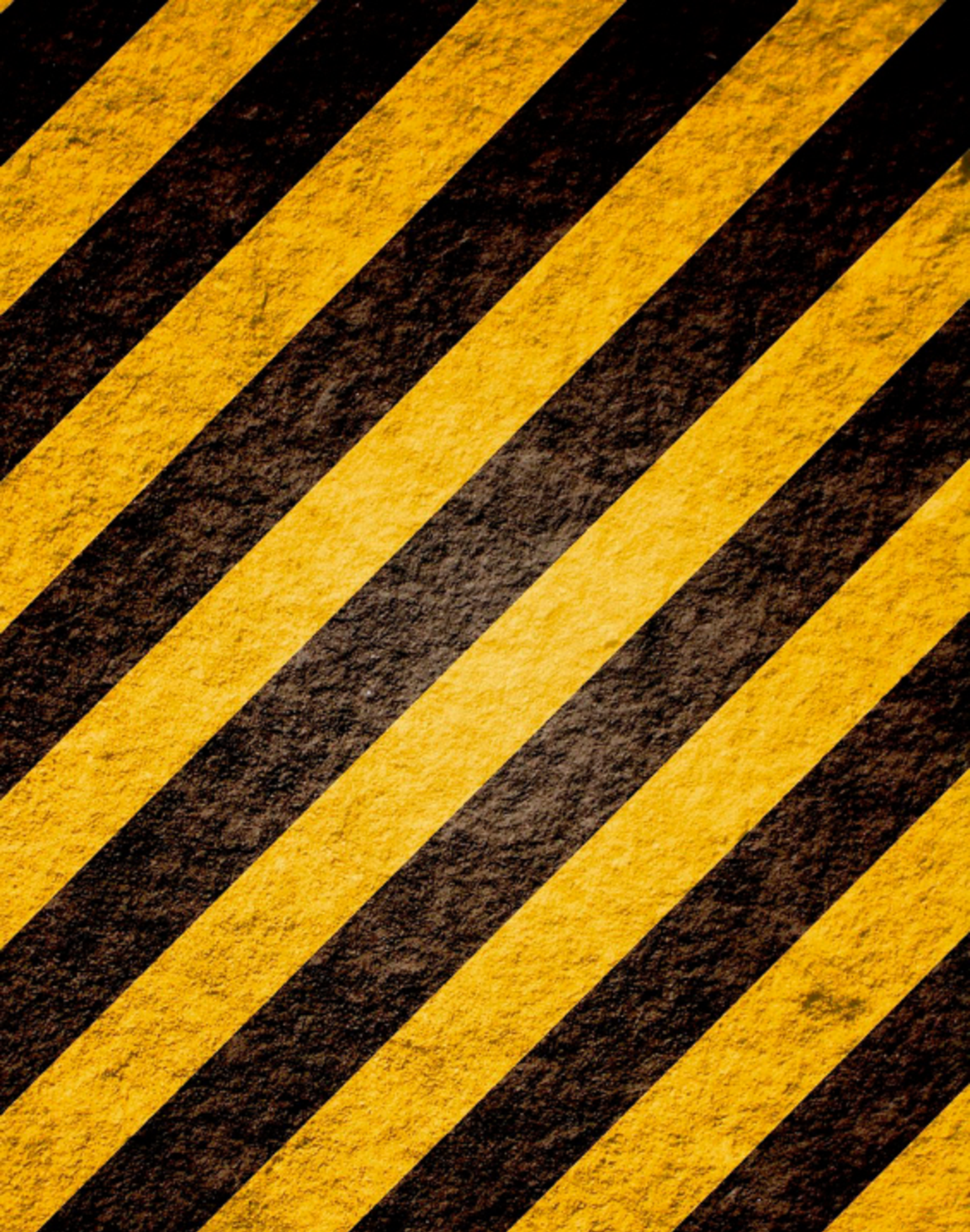 mottled concrete with diagonal yellow and black hazard stripes