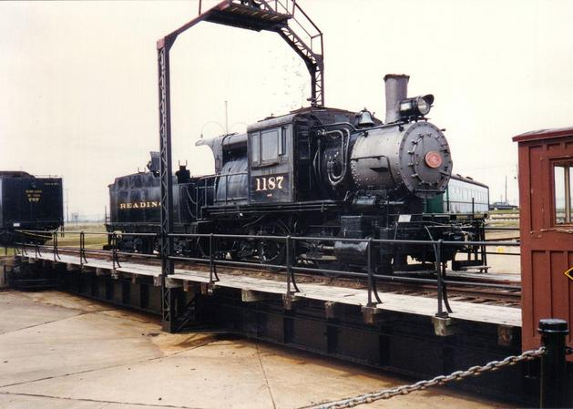 PRR 0-4-0 Camelback steam locomotive No. 1187 on the turntable at the Strasburg, Pennsylvania Railroad Museum.