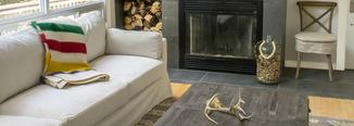 Cottage living room with modern tiled fireplace and crypton slip covered sofa