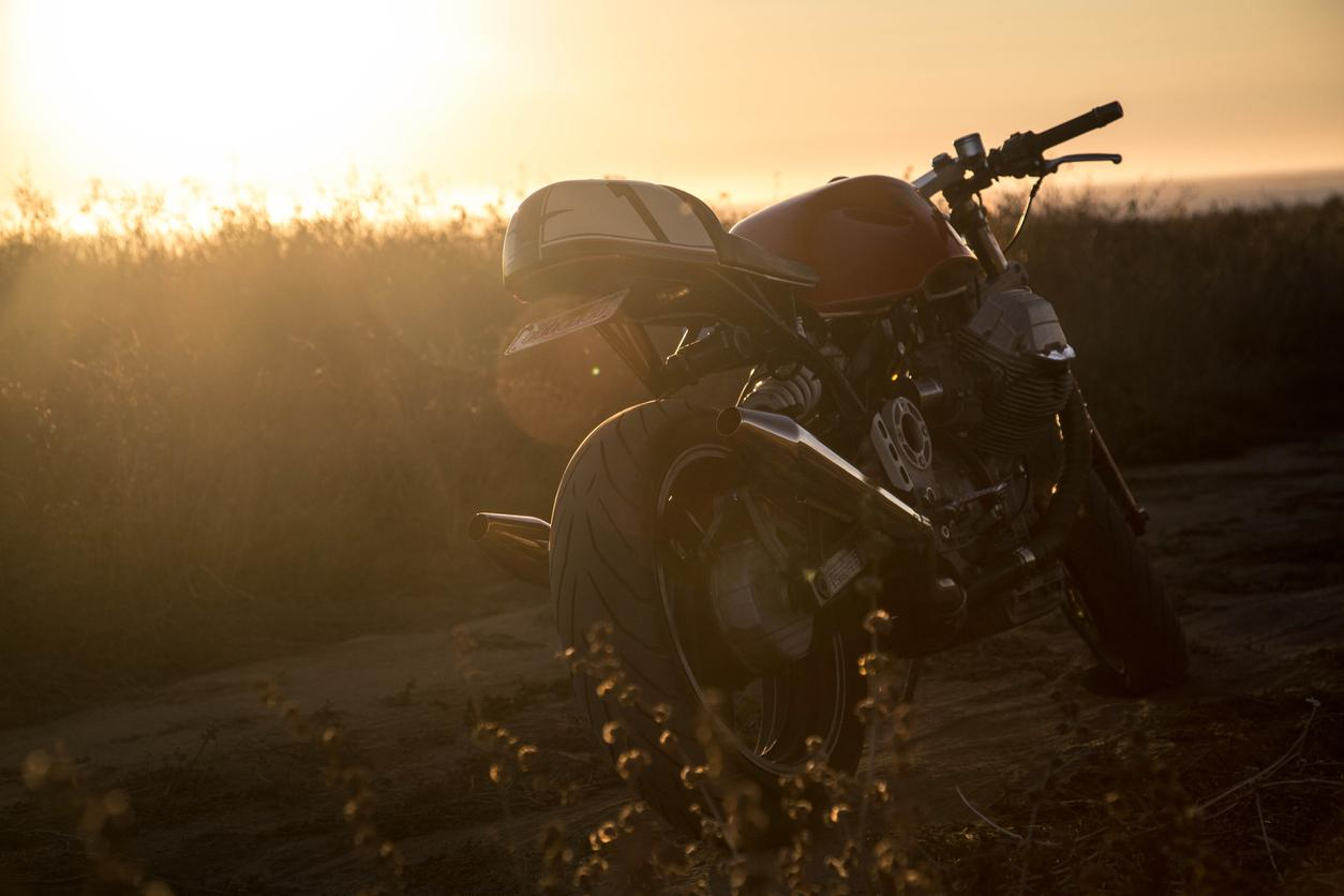 vintage cafe racer motorcycle sunset
