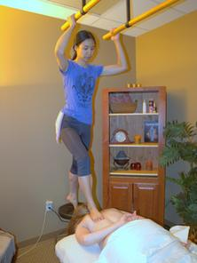 Picture of Jing Liu applying Ashiatsu Barefoot Deep Pressure