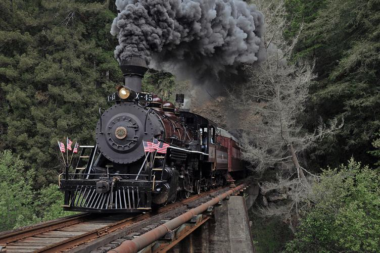 California Western 2-8-2 Mikado No. 45 leads a photo special eastbound at the first crossing of the Noyo River in 2009. Photo by Drew Jacksich.
