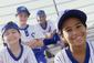 4 Young boys and girls in baseball uniforms smiling like they are having fun