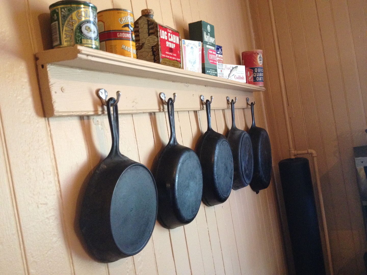 Cast Iron Pans Hanging in the Kitchen
