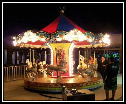 lit up carousel at night