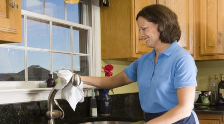 House Cleaning. maid cleaning a kitchen sink