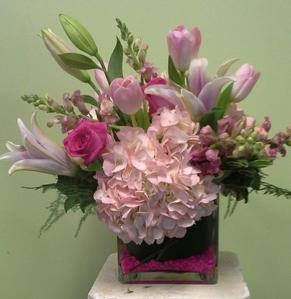 Beautiful cut garden stems in a vase. Designed in a 6'' cube with hydrangea, oriental lilies, snapdragons, tulips, roses, and a variety of foliage.