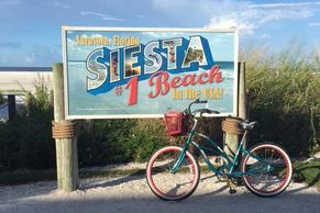 Siesta Key #1 Beach Poster with Bike in front of it.