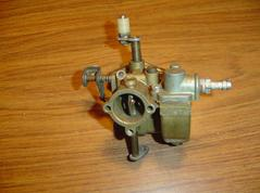 Used carburetor for a 6 hp 1966 to 1967 and 9,.2 hp 1966 - 1967 Chrysler outboard motor. F197061-1, MT91B and F291061, MT97A