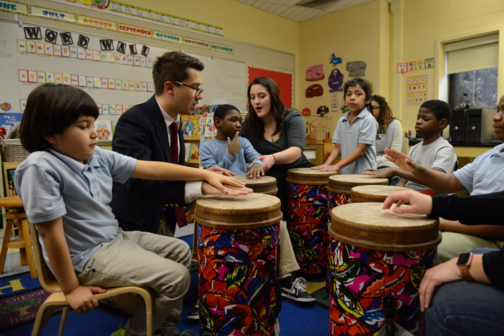 Rider students teach children drumming